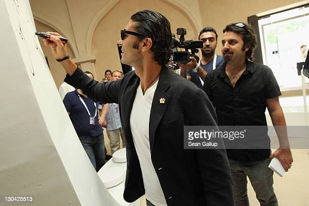 Actor Khaled Nabawy and Director of Education Filmmaker Scandar Copti attend the Opening Of 'Harrer Harrer' Video Exhibition at Katara Cultural...