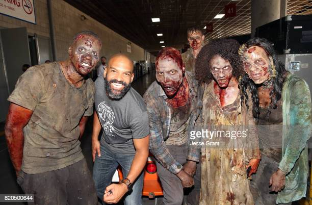 Actor Khary Payton from The Walking Dead poses with zombies at San Diego ComicCon International 2017 at the San Diego Convention Center on July 21...