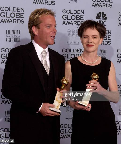 Actor Kiefer Sutherland and actress Judy Davis pose with their Golden Globe awards at the 59th Annual Golden Globe Awards at the Beverly Hilton in...