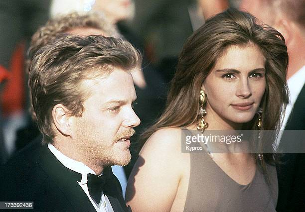 Actor Kiefer Sutherland and actress Julia Roberts attend the 62nd Annual Academy Awards on March 26 1990 at Dorothy Chandler Pavilion Music Center in...