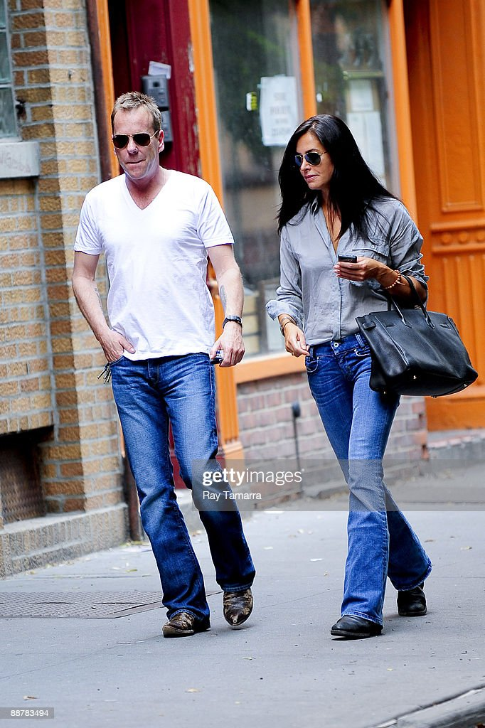 Actor Kiefer Sutherland (L) and Allure magazine style director Siobhan Bonnouvrier walk in the West Village neighborhood of Manhattan July 1, 2009 in New York City.
