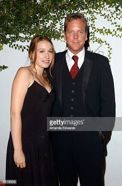 Actor Kiefer Sutherland and his daughter Sarah arrive at the Fox TV Emmy After Party at Mortons on September 21 2003 in West Hollywood California