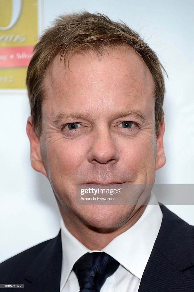 Actor Kiefer Sutherland arrives at the 10th Annual Opening Doors Awards benefiting the Millennium Momentum Foundation at Dorothy Chandler Pavilion on November 16, 2012 in Los Angeles, California.