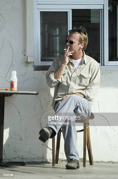Actor Kiefer Sutherland waits for his food at the Sunset Grill March 5 2002 in West Hollywood CA