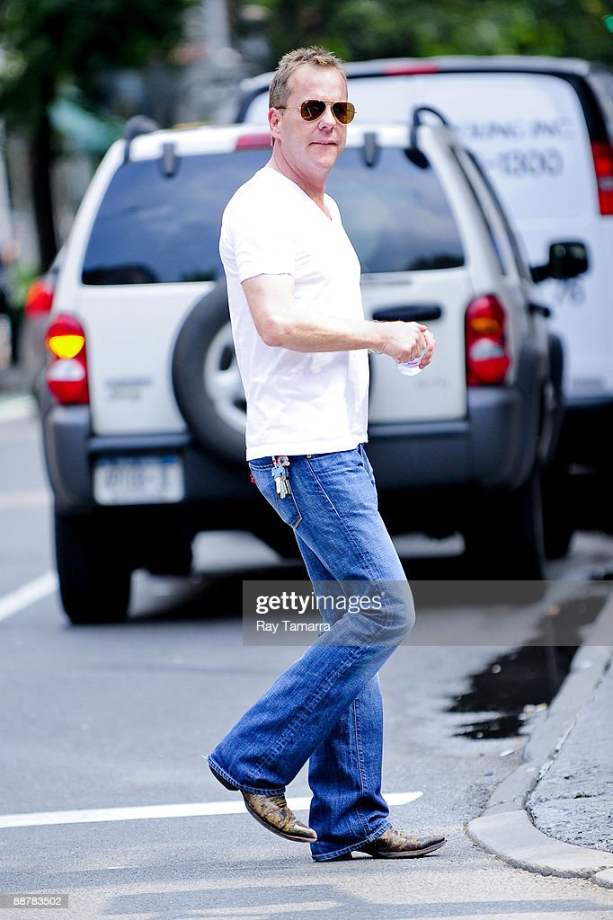 Actor Kiefer Sutherland walks in the West Village neighborhood of Manhattan July 1, 2009 in New York City.