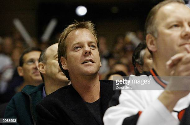 Actor Kiefer Sutherland watches game seven of the 2003 Stanley Cup Finals as the Mighty Ducks of Anaheim take on the New Jersey Devils on June 9 2003...