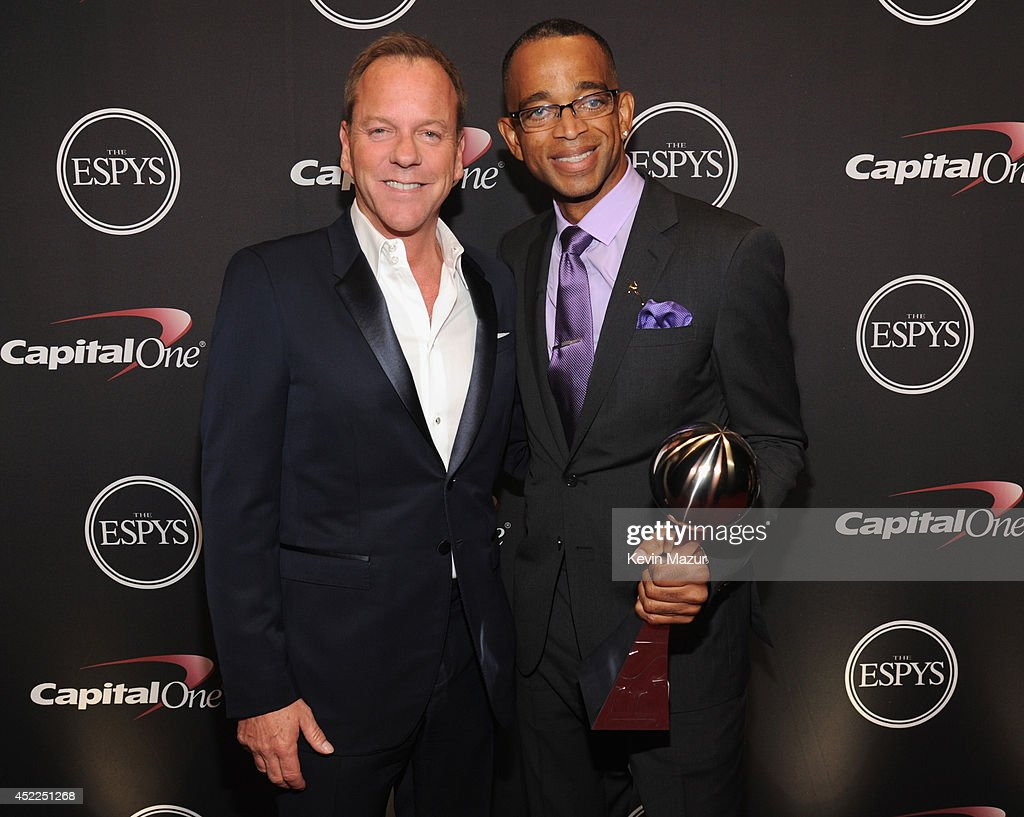 Actor Kiefer Sutherland with ESPN anchor Stuart Scott backstage at The 2014 ESPY Awards at Nokia Theatre L.A. Live on July 16, 2014 in Los Angeles, California.