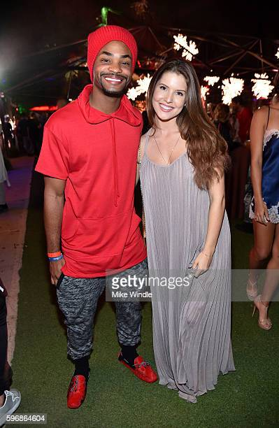 Actor King Bach and model Amanda Cerny attend the annual Midsummer Night's Dream party hosted by Hugh Hefner at The Playboy Mansion on August 27 2016...