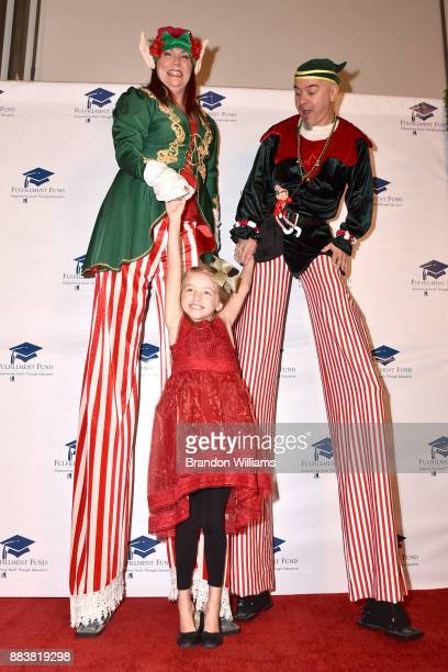 Actor Kingston Foster poses with some Christmas elves at The Fulfillment Fund's 45th Annual Holiday Party for Kids at CBS Televison City on December...