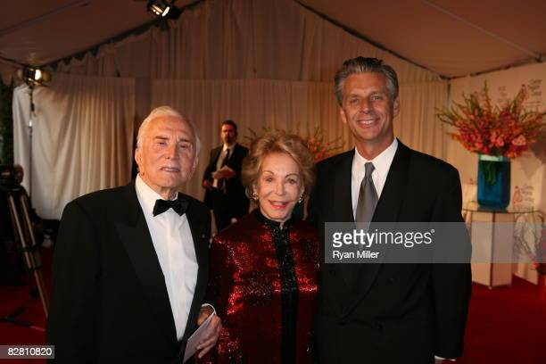 Actor Kirk and Anne Douglas pose with CTG Artistic Director Michael Ritchie during the grand reopening gala for the Mark Taper Forum on September 13...