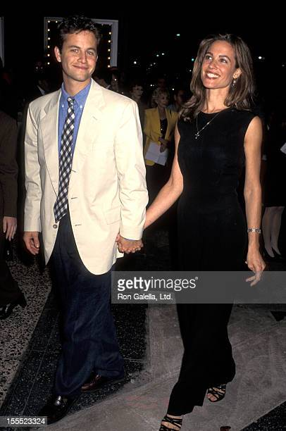Actor Kirk Cameron and actress Chelsea Noble arrive at A Concert of Hope Benefit on October 16 1995 at the Pantages Theater in Hollywood California