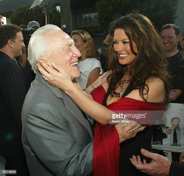 "Actor Kirk Douglas and his daughter-in-law/actress Catherine Zeta-Jones arrive at the premiere of ""The In-Laws"" at the Cinerama Dome May 19, 2003 in..."