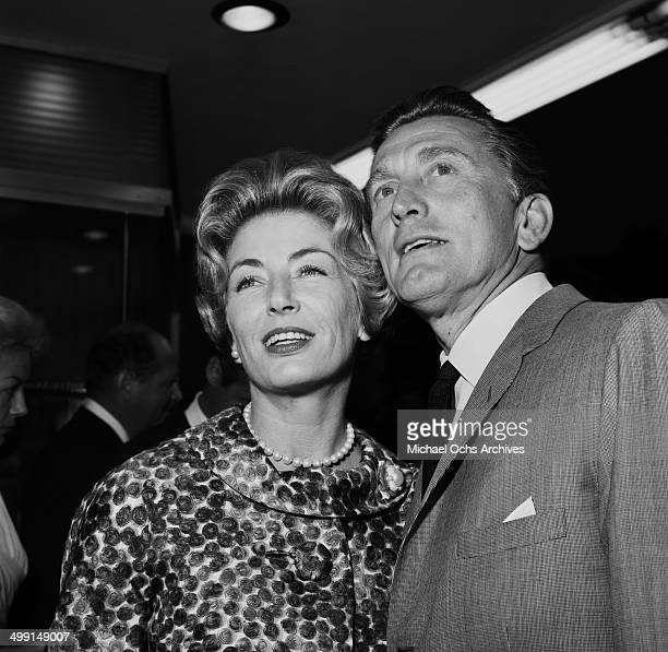 Actor Kirk Douglas and his wife Anne Buydens arrive for a party in Los Angeles California