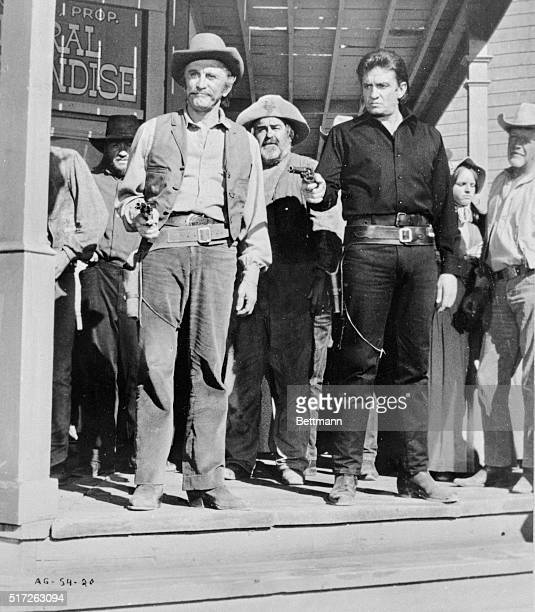 Actor Kirk Douglas and Johnny Cash are shown in a scene from the movie A Gunfight directed by Lamont Johnson