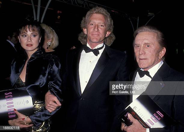 Actor Kirk Douglas and Peter Douglas attend the premiere of Scrooged on November 17 1988 at Mann Chinese Theater in Hollywood California