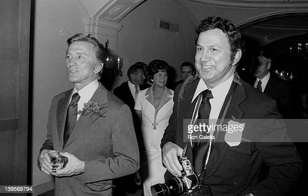 Actor Kirk Douglas and photographer Ron Galella attend United Neighborhood Houses Dinner Gala on June 2 1975 at the Pierre Hotel in New York City