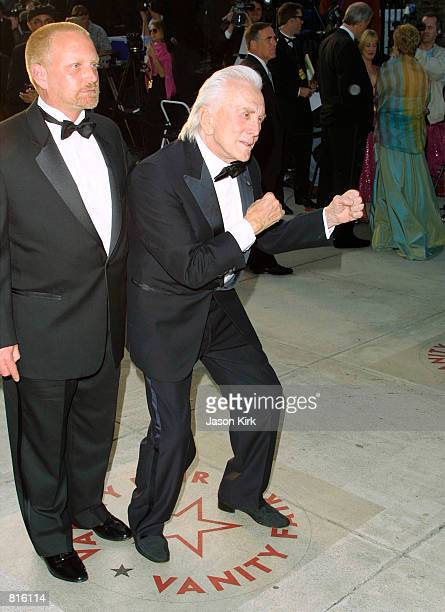 Actor Kirk Douglas and son Eric arrive at the Vanity Fair postOscars party March 25 2001 at Morton's restaurant in Beverly Hills