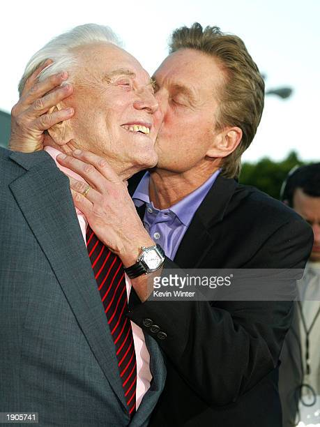 Actor Kirk Douglas and son producer/actor Michael Douglas arrive at the premiere of It Runs In The Family at the Bruin Theater on April 7 2003 in Los...