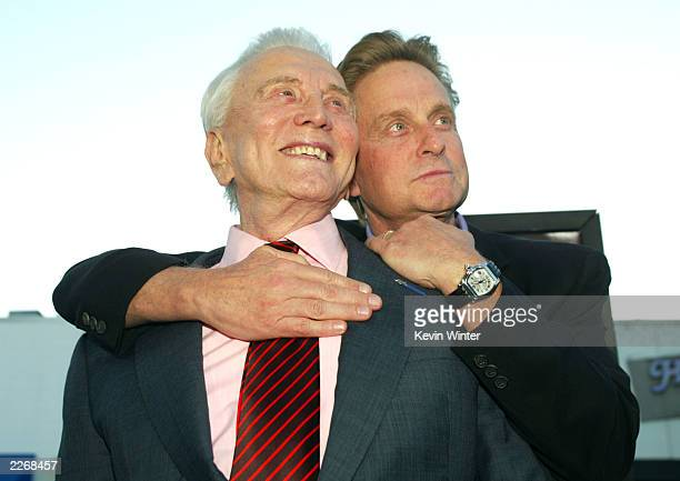 "Actor Kirk Douglas and son producer/actor Michael Douglas arrive at the premiere of ""It Runs In The Family"" at the Bruin Theater April 7, 2003 in Los..."