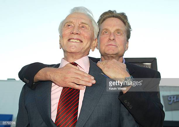 "Actor Kirk Douglas and son producer/actor Michael Douglas arrive at the premiere of ""It Runs In The Family"" at the Bruin Theater on April 7, 2003 in..."