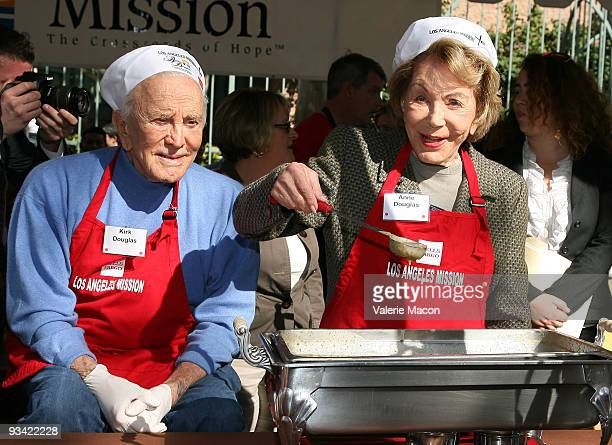 Actor Kirk Douglas and wife Anne attends the Los Angeles Mission Thanksgiving meal for the homeless at Los Angeles Mission on November 25 2009 in Los...
