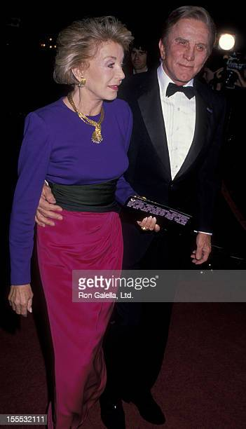 Actor Kirk Douglas and wife Anne Douglas attend the premiere of Scrooged on November 17 1988 at Mann Chinese Theater in Hollywood California
