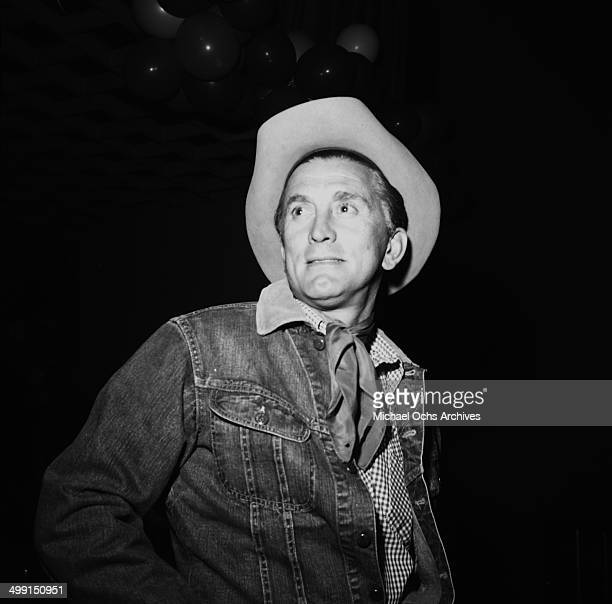 Actor Kirk Douglas arrive for a party in Los Angeles California