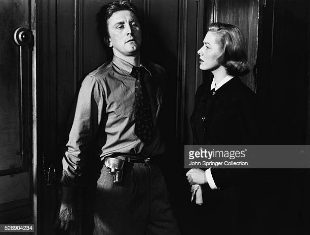 Actor Kirk Douglas as Detective James McLeod with actress Eleanor Parker as his wife Mary McLeod in the 1951 film Detective Story.