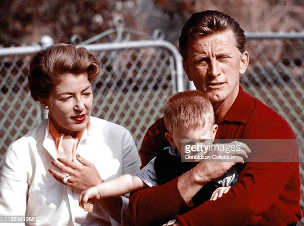 Actor Kirk Douglas at home with his wife Anne Buydens his son Peter Vincent Douglas on February 14 1957 in Los Angeles