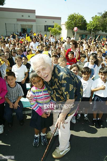 Actor Kirk Douglas is seen with pupils at Florence Avenue School on September 3 2003 in South Los Angeles California Kirk and Anna Douglas have...