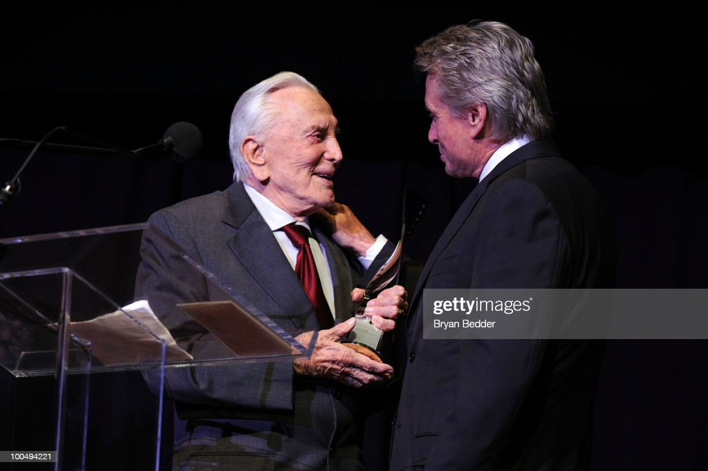Actor Kirk Douglas presents his son actor Michael Douglas with a award at the The Film Society of Lincoln Center's 37th Annual Chaplin Award gala at Alice Tully Hall on May 24, 2010 in New York City.