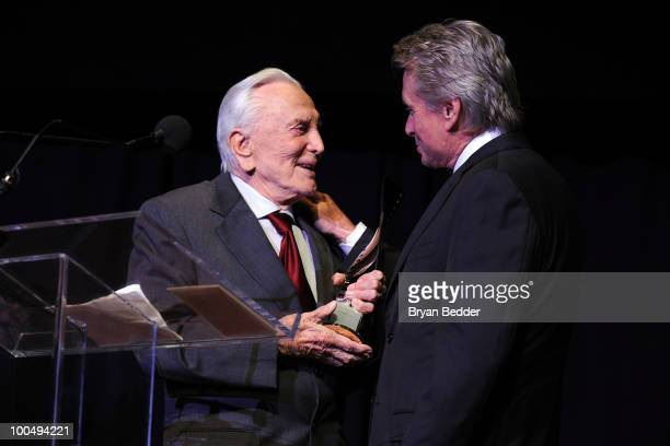Actor Kirk Douglas presents his son actor Michael Douglas with a award at the The Film Society of Lincoln Center's 37th Annual Chaplin Award gala at...