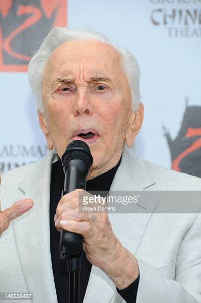 Actor Kirk Douglas rededicates his hand and footprints first set in cement fifty years ago at Grauman's Chinese Theatre on June 12 2012 in Hollywood...