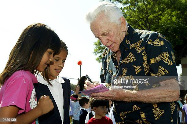 Actor Kirk Douglas signs autographs for pupils at Florence Avenue School on September 3 2003 in South Los Angeles California Kirk and Anna Douglas...