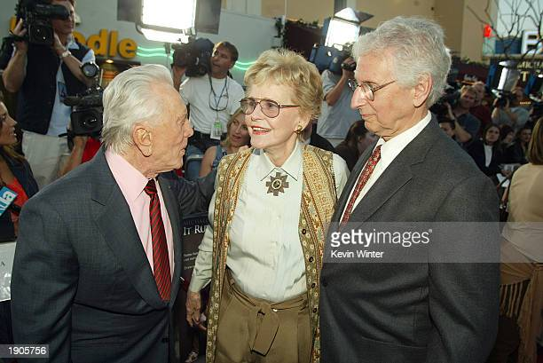 """Actor Kirk Douglas talks with actress and ex-wife Diana Douglas and her husband Donald Webster at the premiere of """"It Runs In The Family"""" at the..."""