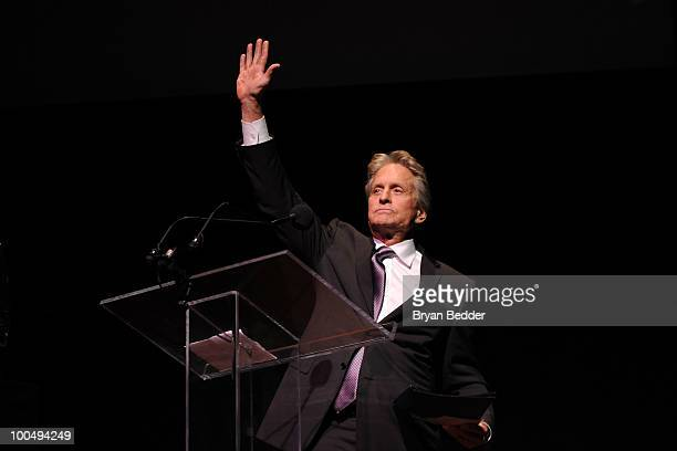Actor Kirk Douglas waves onstage while being honored at the The Film Society of Lincoln Center's 37th Annual Chaplin Award gala at Alice Tully Hall...