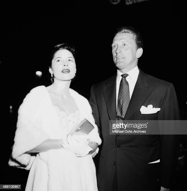 Actor Kirk Douglas with Irene Wrightsman at the premier of 'Along the Great Divide' in Los Angeles California