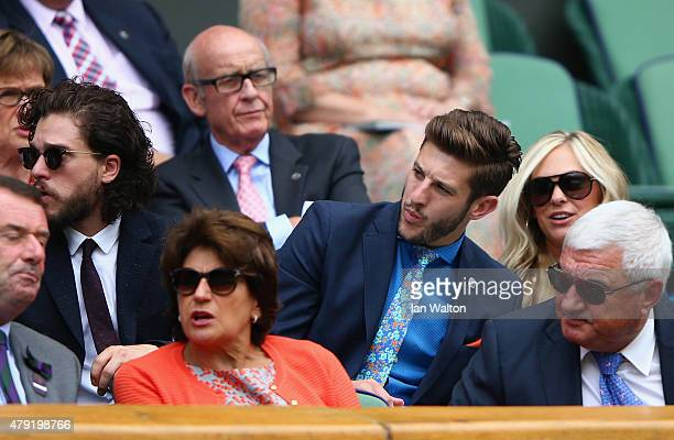 Actor Kit Harington and Liverpool and England footballer Adam Lallana look on from Centre Court during day four of the Wimbledon Lawn Tennis...