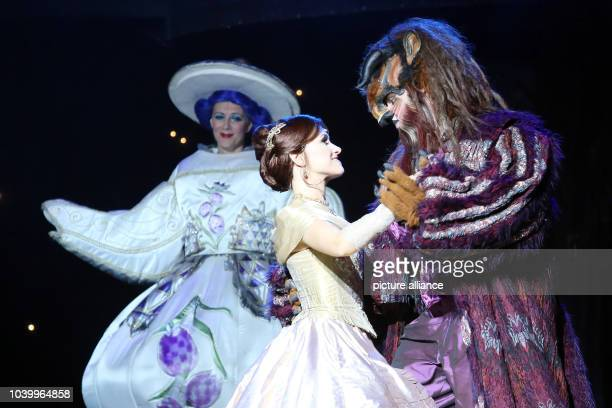 Actor Kitty Jenes as Belle and Sandor Barkoczi as Beast of the Budapest Operette and MusicalTheater perform during a photo rehearsal of the musical...