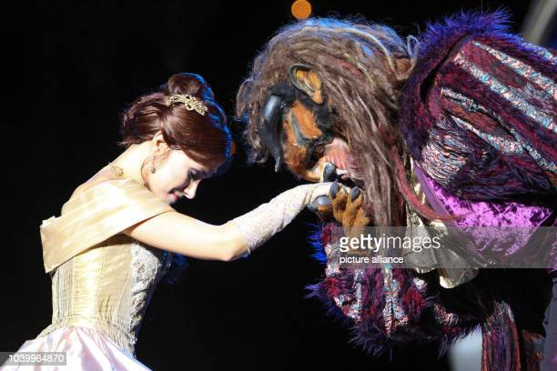 Actor Kitty Jenes as Belle and Sandor Barkoczi as Beast of the Budapest Operette and Musical Theater perform during a photo rehearsal of the musical...