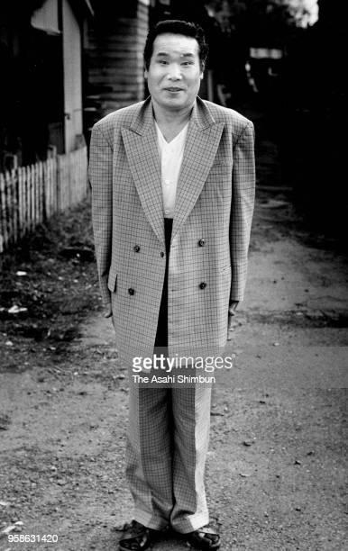 Actor Kiyoshi Atsumi poses on the set of movie 'OtokohaTsuraiyo' on December 1 1990 in Kamakura Kanagawa Japan
