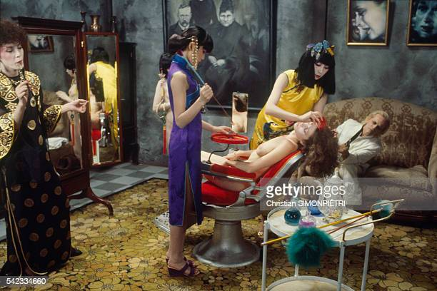 Actor Klaus Kinski and actresses on the set of movie Fruits of Passion directed by Shuji Terayama the followup to Histoire d'O