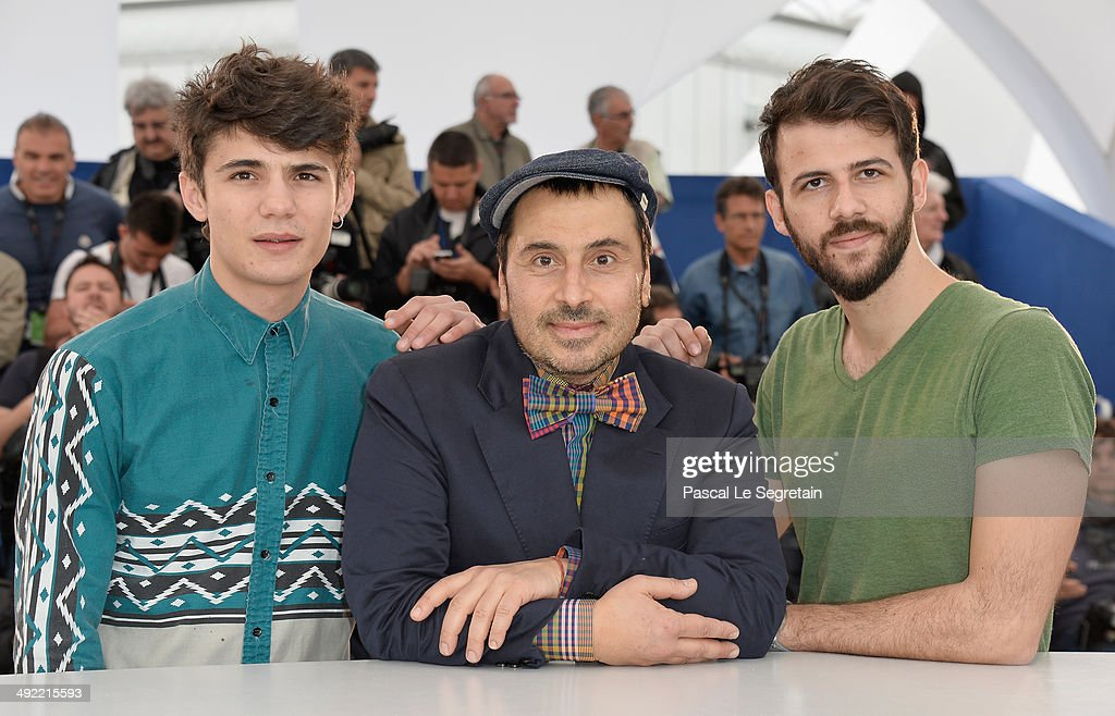 Actor Kostas Nikouli, director Panos Koutras and actor Nikos Gelia attend the 'Xenia' photocall at the 67th Annual Cannes Film Festival on May 19, 2014 in Cannes, France.