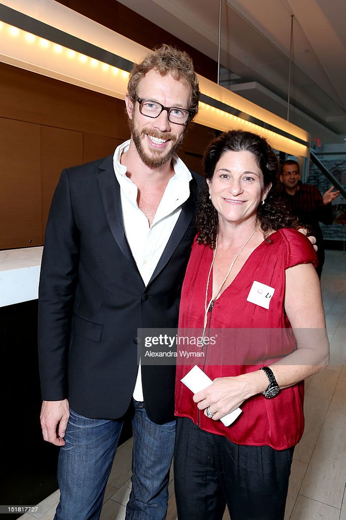 Actor Kris Holden-Ried (L) and FINCA Canada, Director Linda Wolfond attend the FINCA Canada Fundraiser At TIFF 2012 during the Toronto International Film Festival on September 11, 2012 in Toronto, Canada.