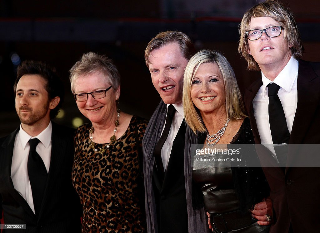 Actor Kris Marshall, actress Olivia Newton-John, director Stephan Elliott and guests attend the 'A Few Best Man' premiere during the 6th International Rome Film Festival at Auditorium Parco Della Musica on October 28, 2011 in Rome, Italy.