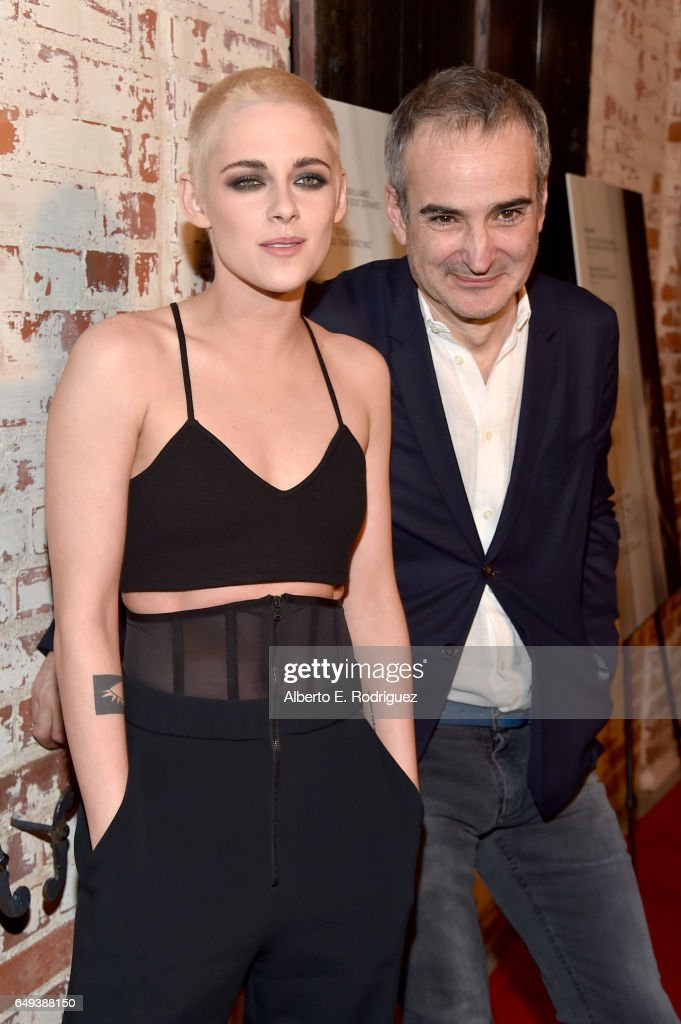 Actor Kristen Stewart (L) and Director Olivier Assayas at the Flux and Cinefamily Hosted Premiere of IFC Films' PERSONAL SHOPPER at The Carondelet House on March 7, 2017 in Los Angeles, California.