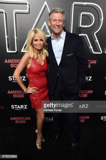 Actor Kristin Chenoweth and Lionsgate CFO James W Barge attend the American Gods premiere at ArcLight Hollywood on April 20 2017 in Los Angeles...