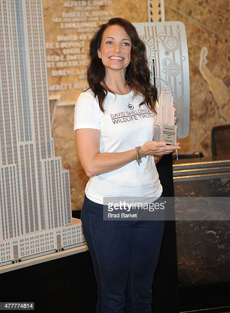 Actor Kristin Davis attends a lighting of The Empire State Building to raise awareness about the elephant crisis at The Empire State Building on June...