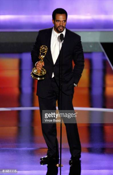 Actor Kristoff St John accepts the Outstanding Supporting Actor In A Drama Series award for The Young and the Restless during the 35th Annual Daytime...