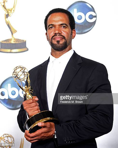 Actor Kristoff St John poses with the Outstanding Supporting Actor In A Drama Series award for The Young and the Restless in the press room at the...